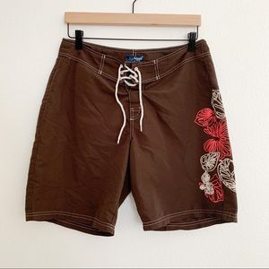 Brown coral and white swim trunks for women